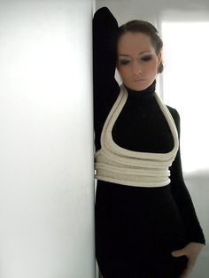 I am not sure what you call this knitted piece of clothing... a mini sweater?  Anyways, I think it looks GREAT... really emphasizes the chest area.  Very modern looking and unusual.  $60