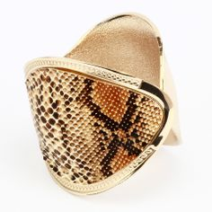 Python print cuff bracelet -  http://www.transfashions.com/en/jewelry/python-print-cuff-bracelet.html Put a dramatic twist to your outfit with this python print cuff #bracelet by Transfashions. This standout piece features a gold band with a python pattern printed on the surface. Its unique design makes it at once...