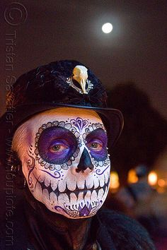 Dia de Los Muertos (San Francisco). Photo taken at the Dia de los Muertos procession in the Mission (San Francisco) on Nov 2, 2011. For more info on this event, please check out my Dia de los Muertos series. bird skull, day of the dead, face painting, Facepaint, Halloween, hat, makeup, man, moon, night, people, skull makeup, sugar skull makeup.