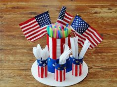 Make a Recycled Patriotic Utensil Holder.  You can use all sorts of different sized cans for this.