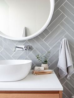 Get the look: Contemporary vs. coastal bathrooms - badezimmer // bathroom - Double herringbone tile pattern – use conventional tiles but more modern feel than traditional su - Budget Bathroom, Bathroom Renos, White Bathroom, Bathroom Wall Tiles, Cozy Bathroom, Bathroom Plants, Bathroom Cabinets, Bathroom Vanities, Bathroom Flooring