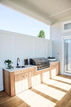 an outdoor kitchen with fully-integrated appliances, blackbutt - Modern Outdoor Kitchen Patio, Outdoor Kitchen Cabinets, Outdoor Kitchen Design, Outdoor Living, Kitchen Decor, Outdoor Decor, Kitchen Ideas, Rustic Outdoor, Room Kitchen