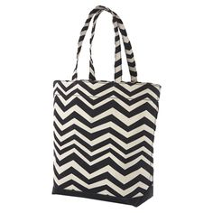 Perfect for a weekend trip or picnic on the beach, this black and white canvas tote bag showcases a chevron motif and 1 interior pocket.   ...