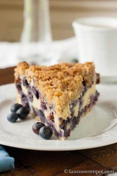 Blueberry Buckle ~ a perfectly moist cake,   chocked full of blueberries, with a special little streusel crunch on top.   Simply divine!