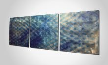 """An abstract metal art entitled """"Blue Expansion"""" which surely be an eye catcher at home and at the office."""