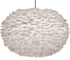 """Says interior-design company owner Heidi Woodman, """"I would use this fabulous light in a bedroom or a woman's office, keep the palette all white, and focus on mixing textures."""""""