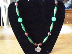 "22"" necklace, long green rice shaped beads and reddish brown glass beads and celtic cross pendant by StrungOnLove on Etsy"