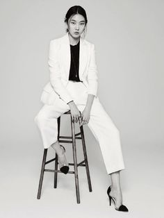han jin basic suit on a stool