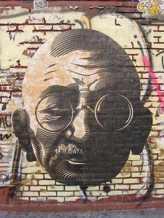 """""""Be the change you want to see in the world.""""  -Mahatma Gandhi  Artist: Cryptik"""