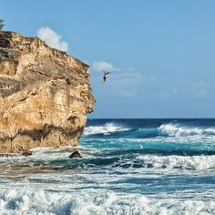 Hawaii sky outdoor water shore Coast Sea cliff Nature Ocean wind wave wave body of water rock Beach terrain vacation cape bay material sand day