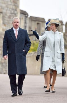 Prince Andrew arrives with Princess Anne who looked elegant in a streamlined mint green dress and coat.