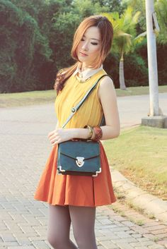 Grey tights, orange skirt and yellow top