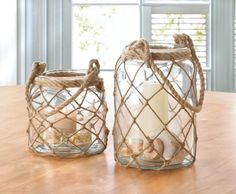 "Candleholders & Candles Home Locomotion Candle not included. Item weight: 3.00lbsItem dimensions: 6.25"" W x 9.50"" H x 6.25"" LMaterials: Glass, Rope"