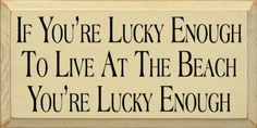 Amazon.com - If you're lucky enough to live at the beach, you're lucky enough Wooden Sign - Home Decor Products
