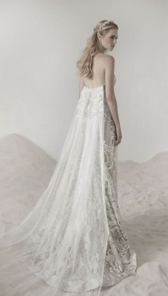 Glamorous silver detailed strapless wedding dress with tulle bridal train; Featured Dress: Lee Petra Grebenau
