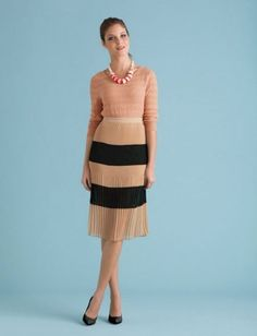 Wear it at night. We love the ballerina-ness of a slim knit sweater with a floaty pleated skirt.