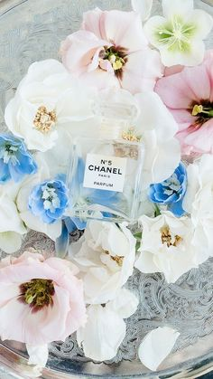 Wedding day flat lay photos, chanel perfume bottle on bed of flowers