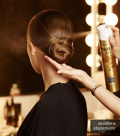 @Who What Wear - Hair: Finish With Hairspray  When all of the hair is incorporated into the low bun, Roszak sprays the finished hairstyle with L'Oreal Paris' Elnett Hairspray Extra Strong Hold Volume ($14.99).