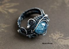 Wire wrapped sterling silver ring with kyanite by honeypunk