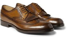 Note the kiltie, that fringe of leather that makes these a bit more jaunty. Fringed leather longwing brogues ($695) by Gucci, mrporter.com