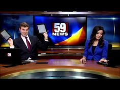 This news anchor dances during a commercial break using iPads as visors, (so he can better see 'where dey at'), whilst his news anchor partner tries to look unimpressed.