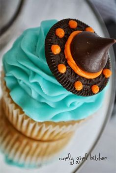 Halloween Cupcakes - make witches' hats from half an Oreo, orange icing, and a Hershey's Kiss!