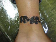 black color elephant ankle tattoo