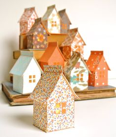Craft a cozy neighborhood of little paper homes using the stitch-n-fold house template combined with photocopied patterned textiles from your own stash of fabrics. Simple and inexpensive to craft, with no need for scoring fold lines, these adorable glowing houses display so sweetly on a