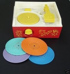 """Fisher Price record player. We had this one when we were little. I used to strap my Barbie doll to the turn table and pretend Benita Bizarre was torturing Joy from the Bugaloos.  I only remember that one of the records played """"Claire de la lune."""""""