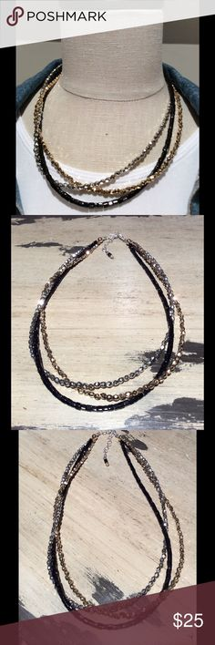 Triple strand necklace Triple strand necklace done with black glass beads, silver and gold acrylic beads. Very light necklace around the neck. 16 inches with a one inch extender.  Choker style. Elegant and feminine. handmade Jewelry Necklaces