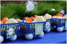 mini golf carts made out of baskets and golf balls for wheels to hold their lunch