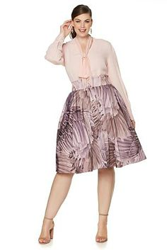 Flaunt your flirtatious side with this tie blouse from Melissa McCarthy Seven7! Where would you wear this whimsical piece?