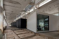 o-office turns an abandoned factory into iD town: the creative art district an abandoned 550-foot long concrete factory is slowly renovated into a thriving art district complete with studios, restaurants, and hotels.
