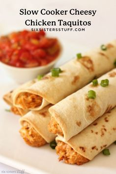 We love an easy dinner recipe and our Slow Cooker Cheesy Chicken Taquitos are a family favorite. These taquitos are a healthier homemade version than store bought or restaurant made (they're baked, not fried!).