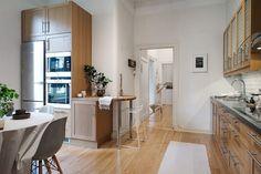 cocina con mesa - ¿Estilo clásico o nórdico? ¡Esta casa combina los dos!