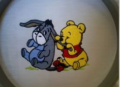 """This free embroidery design is """"Winnie the Pooh Bites Eeyore"""". Thanks to EmbroideryDesigns.com for posting it."""