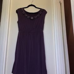 Banana Republic Beaded dress Very cute eggplant purple beaded neckline dress by Banana Republic.  Sleeveless. Has a banded waist.  Slits on both sides.  Sits just above the knee. Good condition. Very few of the beads are missing. Banana Republic Dresses