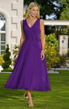 Feminine tea length chiffon occasion wedding bridesmaid dress in a beautiful Cadbury purple colour Beautiful pleated V neckline bodice Bodice is