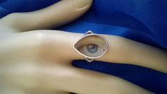 I have always been fascinated by Lovers Eye jewellery and started to make my own pieces because of the rarity and expense of the originals. Lovers eyes were a mysterious way of keeping your mistress or secret lover close to you during the Georgian era.  This teardrop ring is 925 sterling silver and the eye has been embellished with diamond look tears for added romance and drama 💘 The ring is a size L, US size 6. The front of the ring is a little under 2cm wide. A beautiful blue eye.