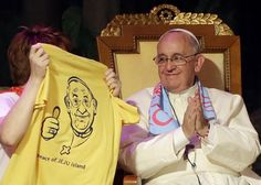 Photo -- #PopeFrancis is presented with a T-shirt during his meeting with youth at the Solmoe Sanctuay.