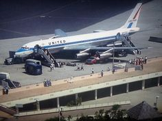 """United Air Lines Douglas DC-8-21 N8029U """"Mainliner James M. Doolittle"""" during a time when open air viewing platforms were the norm at most airports, circa 1960s."""