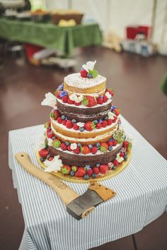Naked wedding cake decorated with fruit berries - Image by Matt Ethan Photography - Bride wears a Sincerity Bridal gown at a rustic outdoor wedding in Norfolk with nautical colour scheme. Wedding Cake Decorations, Wedding Cake Designs, Wedding Cake Toppers, Wedding Cakes, Cake Decorated With Fruit, Cake Pop Decorating, Wedding Snacks, Big Cakes, Wedding Cake Inspiration