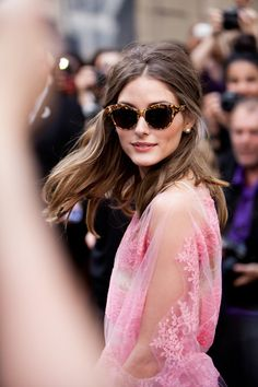 Olivia Palermo with half-up wavy hair