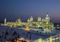 This photo show the size of these amazing ice sculptures at the Harbin Ice & Snow Sculpture Festival in China.  It must be an amazing experience to visit this festival.