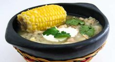 Ajiaco Bogotano - Colombian Chicken and Potato Soup - The soup is typically served with table cream, capers and avocado all mixed in just before eating in the proportions each individual prefers. Ajiaco is so heavy that it is usually considered a full meal. In Colombian cuisine, this is the most representative dish of Bogotá. - http://aussietaste.recipes/vegetables/potato/ajiaco-bogotano-colombian-chicken-and-potato-soup/ - #recipe