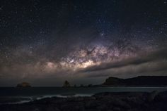 """Stardust °°° - The """"Pointe des Châteaux"""", eastern end of Guadeloupe. The sun has just set and the center of the galaxy rises just above the horizon ... The sea is unleashed and the sky is very dark, no light pollution, just a few low clouds come off the Atlantic Ocean. An unforgettable moment. Four images were assembled with photoshop to reduce the noise of the sensor."""