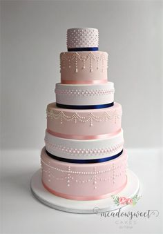 Pale pink and bold blue is a winning colour combo - just look at this stunning wedding cake!