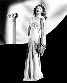 """Rita Hayworth, publicity portrait for """"Cover Girl"""", 1944. Miss Hayworth's gown was designed by Travis Banton."""