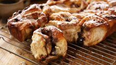 Chocolate and cherry buns recipe - BBC Food Chelsea Bun Recipe, Hairy Bikers, Roasting Tins, Sticky Buns, Instant Yeast, Cake Tins, Vegetarian Chocolate, Cinnamon Rolls, Tray Bakes