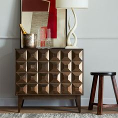 The Lubna Chowdhary Tiled Buffet from West Elm ....you know,  it took me a while to fall for these pyramid-studded furniture pieces, but you know what??? I like them, in just the right pieces and places. Like this. Perfect for my dream living room.